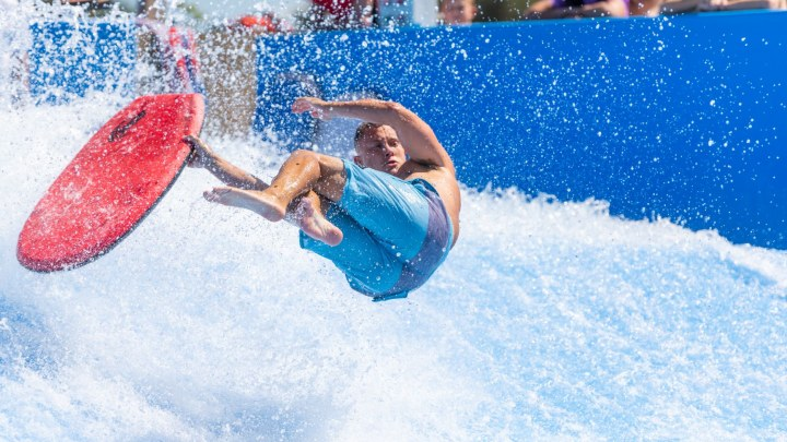 surfer on flow rider with blue shorts