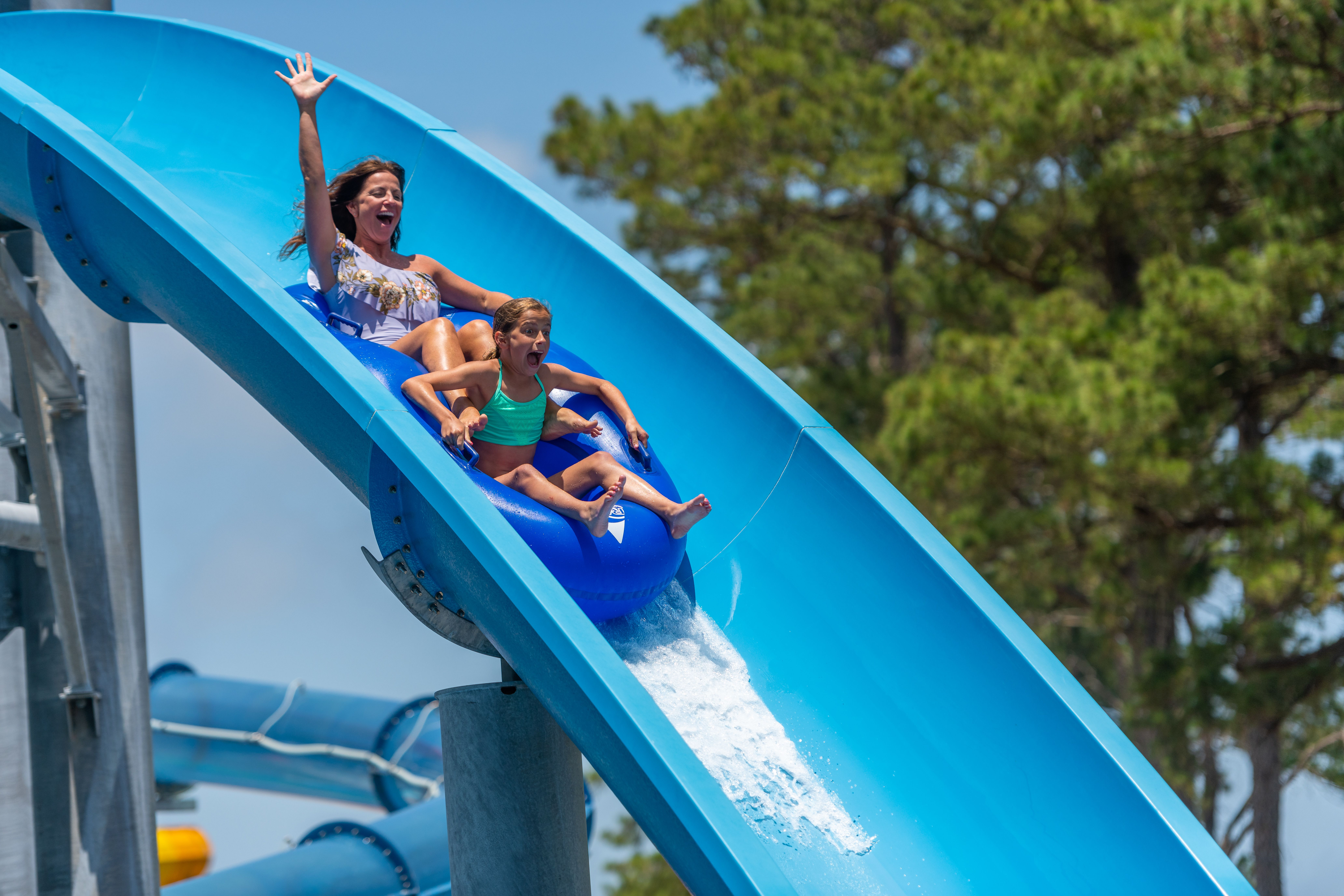 mother daughter on blue slide