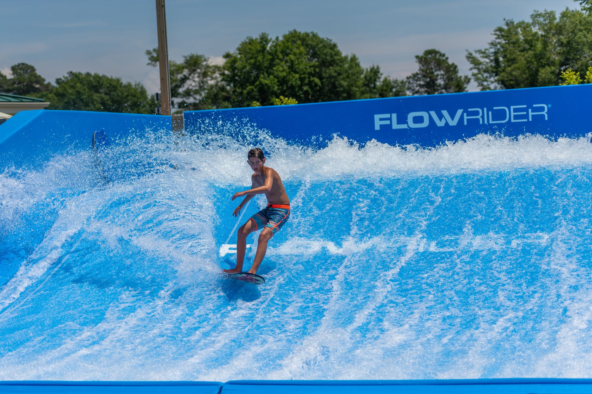 Young girl boogie boarding on the Flow Rider.
