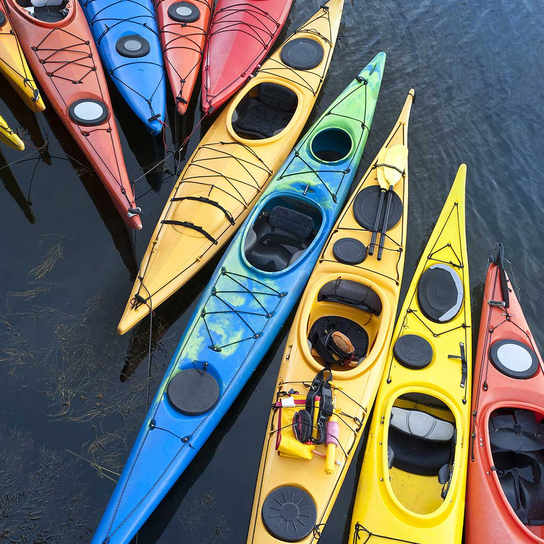 Group of colorful Kayaks