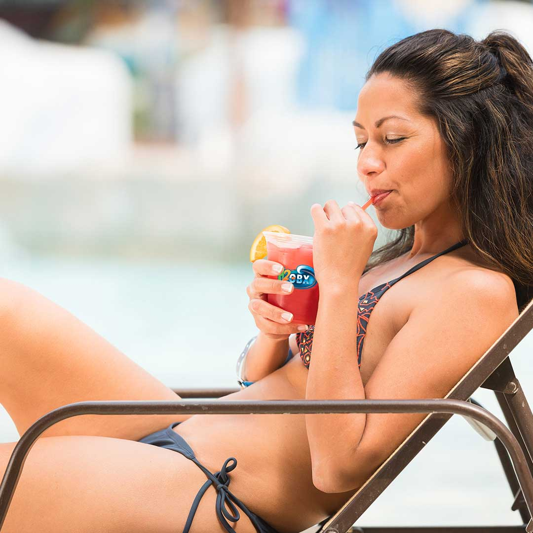 Woman lounging with drink